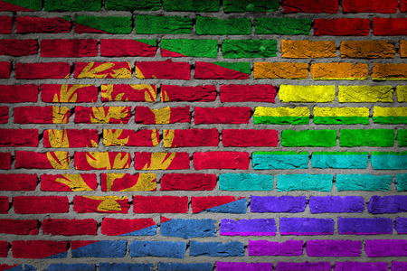 lesbo: Dark brick wall texture - coutry flag and rainbow flag painted on wall - Eritrea