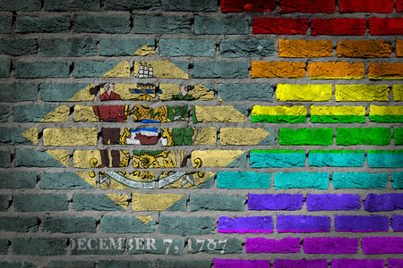 lesbo: Dark brick wall texture - coutry flag and rainbow flag painted on wall - Delaware