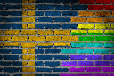lesbo: Dark brick wall texture - coutry flag and rainbow flag painted on wall - Sweden