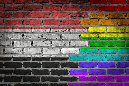 lesbo: Dark brick wall texture - coutry flag and rainbow flag painted on wall - Yemen Stock Photo