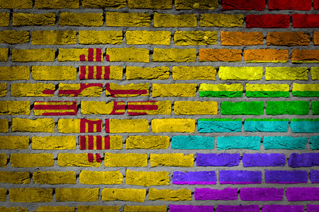 lesbo: Dark brick wall texture - coutry flag and rainbow flag painted on wall - New Mexico
