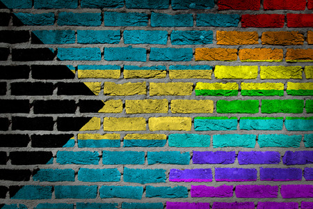 lesbo: Dark brick wall texture - coutry flag and rainbow flag painted on wall - Bahamas