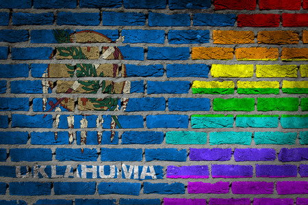 lesbo: Dark brick wall texture - coutry flag and rainbow flag painted on wall - Oklahoma