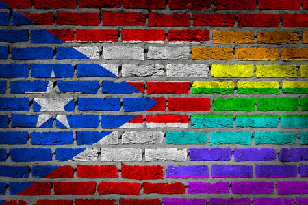 puerto rican flag: Dark brick wall texture - coutry flag and rainbow flag painted on wall - Puerto Rico