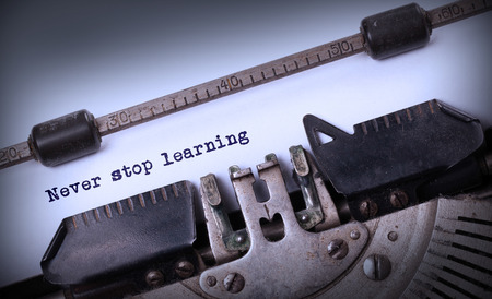 Vintage inscription made by old typewriter, Never stop learning photo