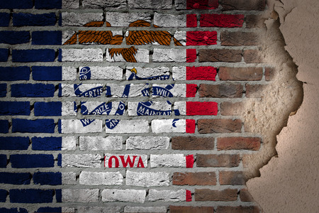 Dark brick wall texture with plaster - flag painted on wall - Iowa photo