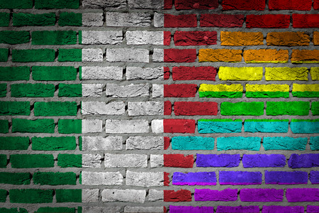 lesbo: Dark brick wall texture - coutry flag and rainbow flag painted on wall - Italy Stock Photo