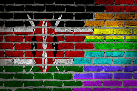 lesbo: Dark brick wall texture - coutry flag and rainbow flag painted on wall - Kenya Stock Photo