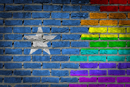 lesbo: Dark brick wall texture - coutry flag and rainbow flag painted on wall - Somalia Stock Photo