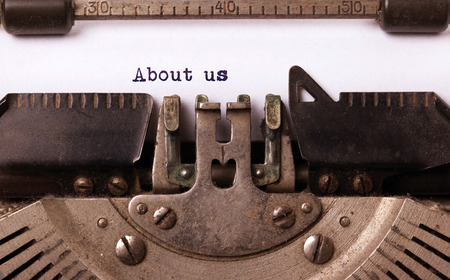 Vintage inscription made by old typewriter, about us Stock Photo - 32267837