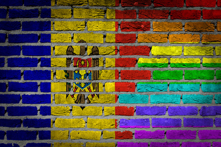 lesbo: Dark brick wall texture - coutry flag and rainbow flag painted on wall - Moldova
