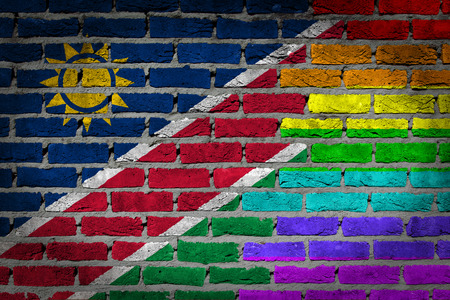 lesbo: Dark brick wall texture - coutry flag and rainbow flag painted on wall - Namibia Stock Photo