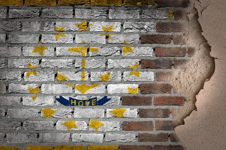 Dark brick wall texture with plaster - flag painted on wall - Rhode Island photo