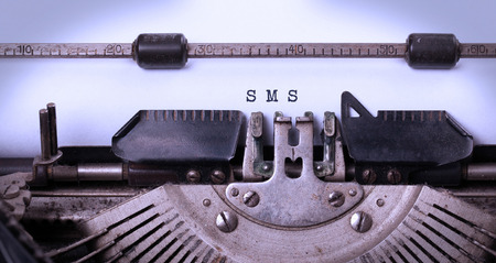 Vintage inscription made by old typewriter, sms photo