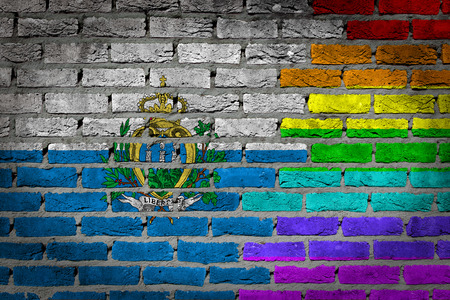 lesbo: Dark brick wall texture - coutry flag and rainbow flag painted on wall - San Marino