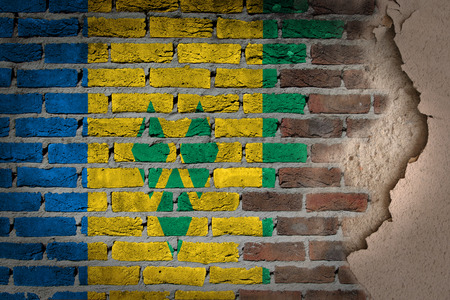 grenadines: Dark brick wall texture with plaster - flag painted on wall - Saint Vincent and the Grenadines Stock Photo