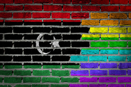 lesbo: Dark brick wall texture - coutry flag and rainbow flag painted on wall - Libya Stock Photo