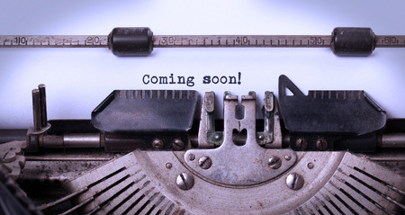 Vintage inscription made by old typewriter, coming soon