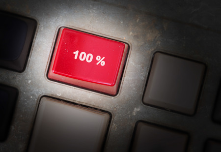discounting: Red button on a dirty old panel, selective focus - 100% Stock Photo