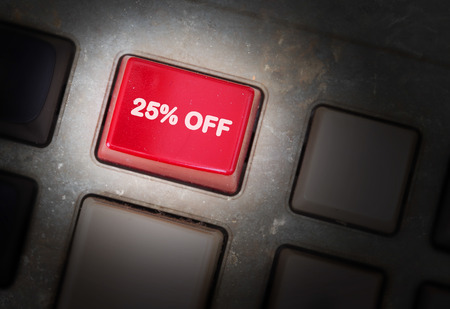 discounting: Red button on a dirty old panel, selective focus - 25% off Stock Photo