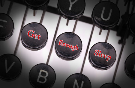 typebar: Typewriter with special buttons, get - enough - sleep Stock Photo
