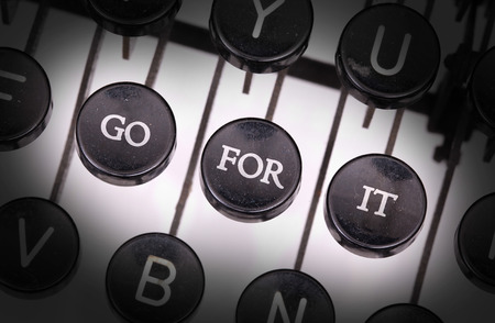 Typewriter with special buttons, go - for - it Stock Photo