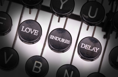 delaying: Typewriter with special buttons, love endures delay