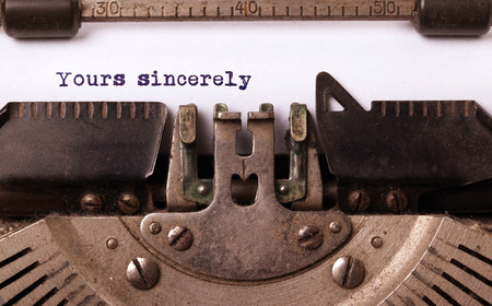sincerely: Vintage inscription made by old typewriter, yours sincerely