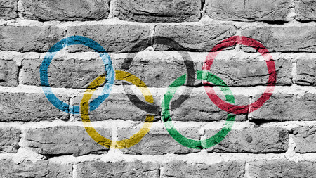 olympic rings: Very old brick wall texture, olympic rings Editorial