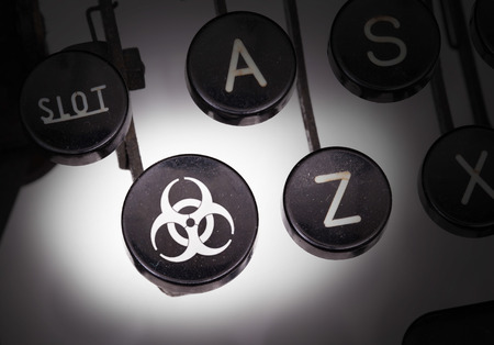 Typewriter with special buttons, biohazard photo