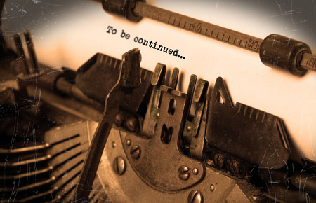 continued: Close-up of an old typewriter with paper, selective focus, to be continued