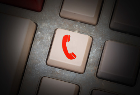 White button on a dirty old panel, selective focus - telephone Stock Photo