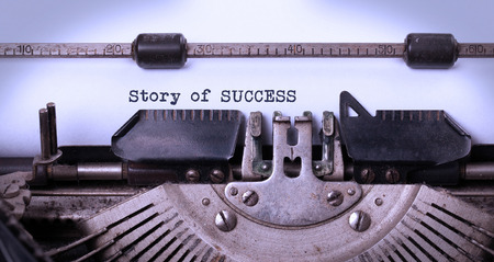 Vintage inscription made by old typewriter, story of success photo