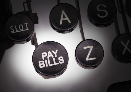 pay bills: Typewriter with special buttons, pay bills Stock Photo