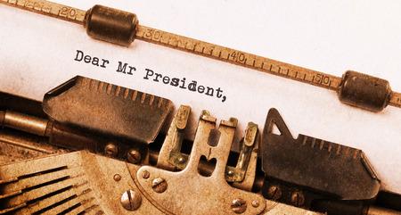 dear: Vintage typewriter, old rusty, warm yellow filter, dear Mr President