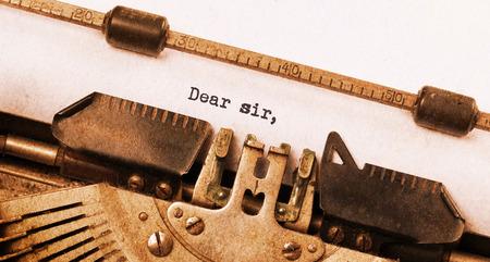 sir: Vintage typewriter, old rusty, warm yellow filter, dear sir