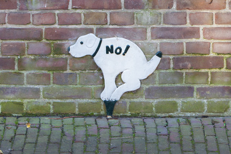 sewage system: Sign prohibiting dogs to take a dump, street in the Netherlands