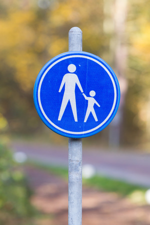 drive safely: Pedestrian with children on road sign, the Netherlands