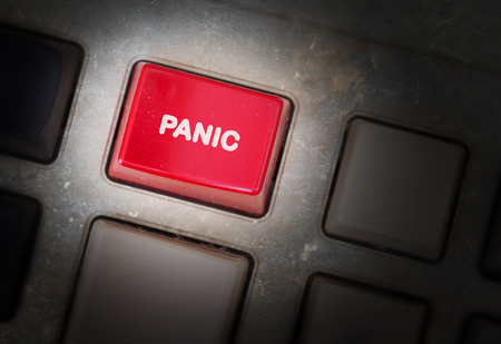 triggers: Red button on a dirty old panel, selective focus - panic Stock Photo