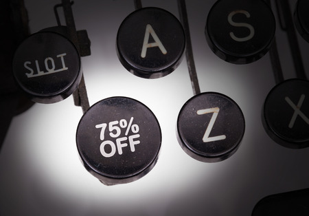 discounting: Typewriter with special buttons, discount Stock Photo