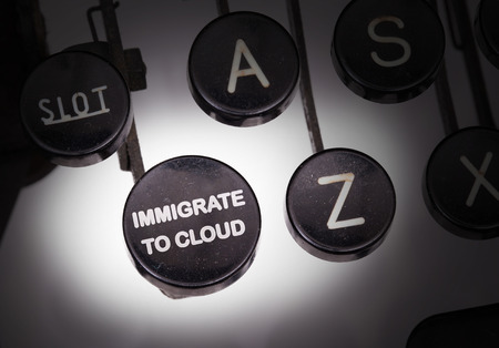 immigrate: Typewriter with special buttons, immigrate to cloud