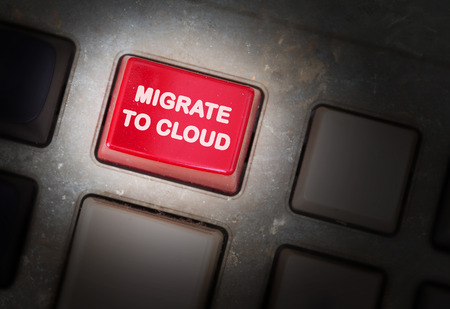 triggers: Red button on a dirty old panel, selective focus - migrate to cloud Stock Photo