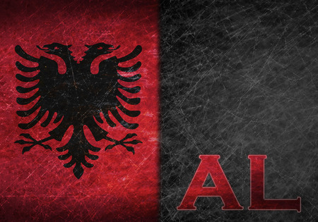 abbreviation: Old rusty metal sign with a flag and country abbreviation - Albania