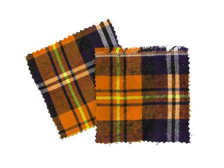 checked fabric: Small piece of the bright scottish checked fabric, orange Stock Photo