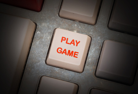 triggers: White button on a dirty old panel, selective focus - play game