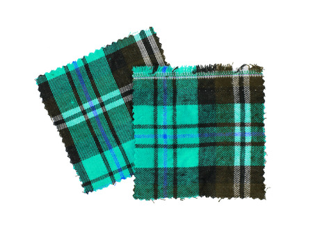 checked fabric: Small piece of the bright scottish checked fabric, green Stock Photo
