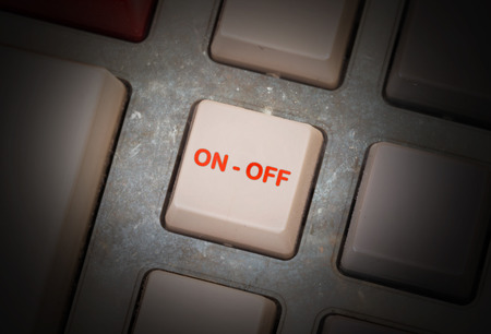 triggers: White button on a dirty old panel, selective focus - on off Stock Photo