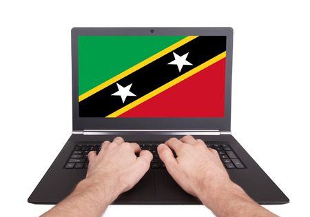 Hands working on laptop showing on the screen the flag of Vanuatu photo