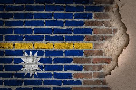 Dark brick wall texture with plaster - flag painted on wall - Nauru