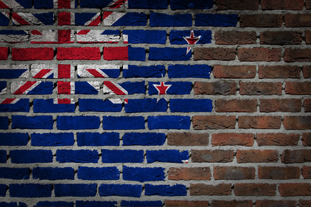 flag of new zealand: Very old dark red brick wall texture with flag - New Zealand